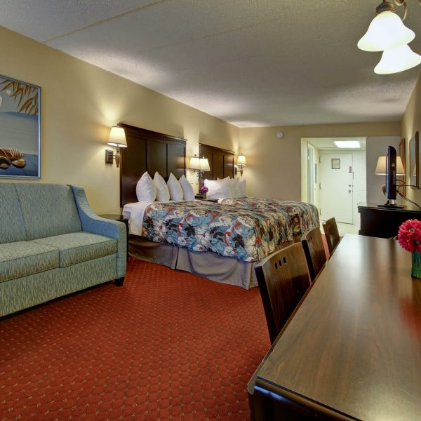 Hotel room with two beds, large couch, and dining table