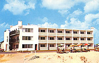 historical photo of The Castle in the Sand Motel exterior view from beach