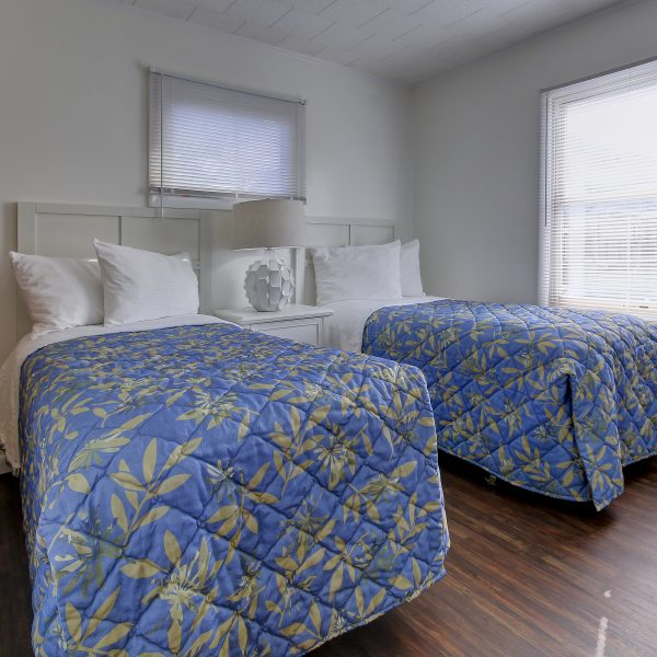 cottage bedroom with 2 twin beds