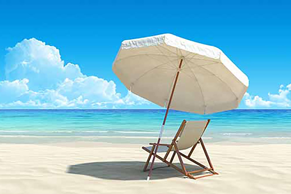 Lounge chair and beach umbrella